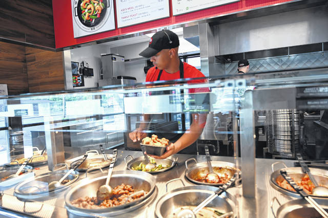 Ira Collier Jr. packs plenty of chicken into a meal at Panda Express, which opened in December.