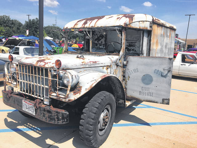 Klark Sweigart and Lucas Coon, both of Lima, are in the process of restoring this 1953 Dodge Military Ambulance.