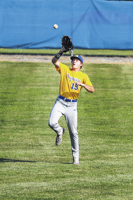 St. Marys' Brayden Trogdlan goes to the air to secure an out during Tuesday night's ACME sectional game against Lima Central Catholics at Bath.