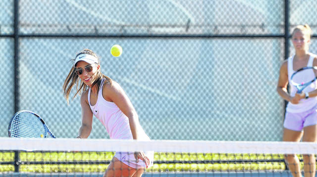 Andrea Arango-Brown, teammate of Olivia Kesner, hits a return during Friday Lima Area Tennis Association city women's doubles play against Mara Stiles and Abby Metzger at the University of Northwestern Ohio.