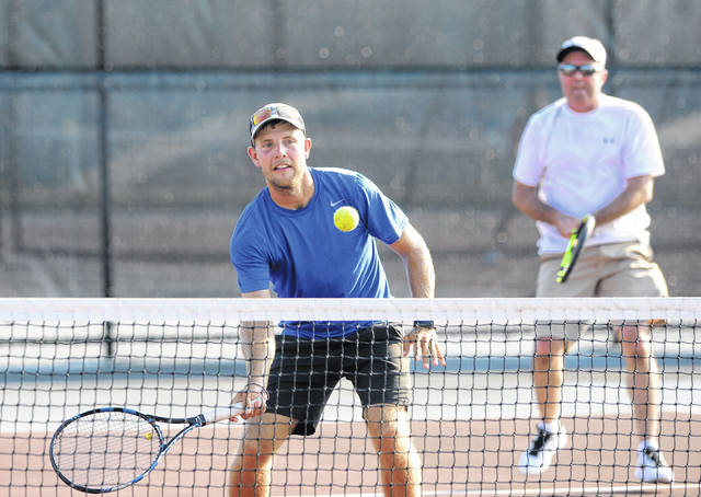 Jeff Brown, teammate off Jeff Arthur, returns a shot during Friday Lima Area Tennis Association city men's doubles play against Mason Stahl and Gabe Burke at the University of Northwestern Ohio.
