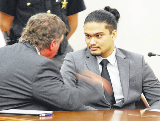 Tristan Ascura, 20, of Lima, is shown with his attorney, Patrick Farrell, prior to entering a plea of guilty to making false statements, a fourth-degree felony, in relations to threats Ascura allegely made more than a year ago against Elida schools.