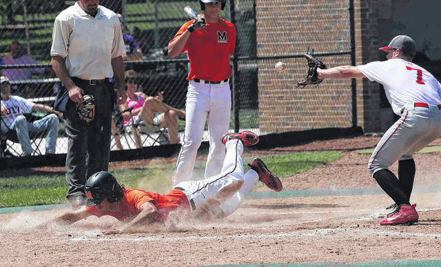 Minster's Austin Brown scores before Van Wert's Owen Treece can get the throw during a Saturday Acme State Tournament game in Coldwater.