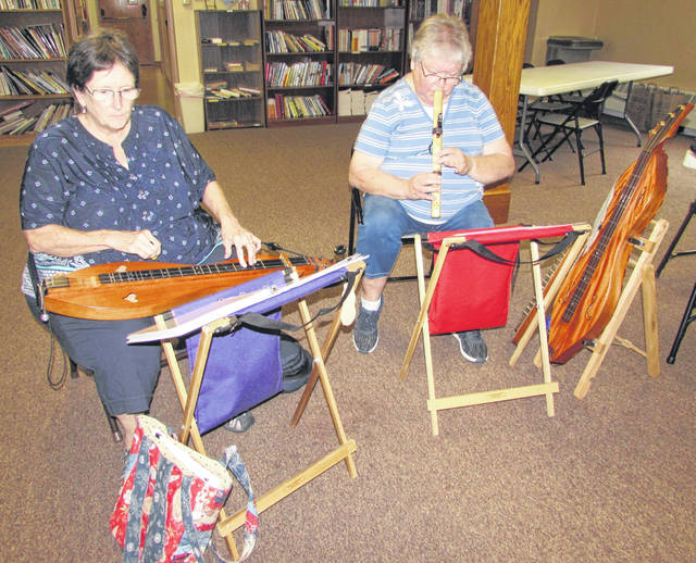 From left are Presbyterian Mountain String members Jane Doepker and Janie Font playing the lap dulcimer and Native American flute.