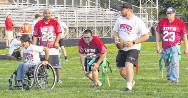 """Participating in the """"Never Give Up Football Camp"""" Friday night in Kenton are, from left: Luke Walker, Trey Hallaway, James Champagne, Derick Cornell and Jamie Keegan."""
