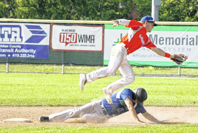 Grand Lake's Layne Riley slides underneath Lima Locos second baseman Xavier Haendigas to record a stolen base during Saturday's game at Simmons Field.