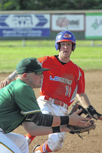 The Lima Locos' Nick Colinas slides safely into the third on a steal attempt against St. Clair's Braxton Pennington during Thursday night's game at Simmons Field.