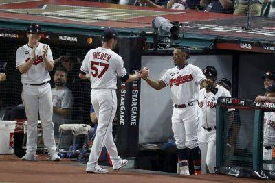 Shane Bieber is congratulated by Indians teammate Francisco Lindor after Bieber struck out the side during the fifth inning of Tuesday night's All-Star Game in Cleveland. (AP photo)