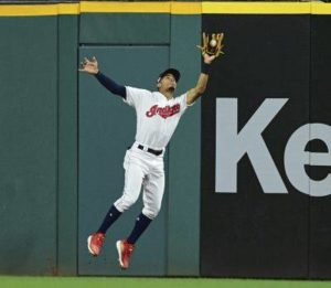 Bauer strikes out 10, Indians win 11th straight against Tigers