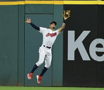 The Indians' Oscar Mercado catches a ball hit by Detroit's Victor Reyes during Thursday night's game in Cleveland. (AP photo)