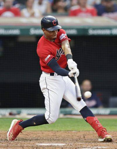 The Indians' Oscar Mercado hits an RBI double, one of his five hits in the game, during the third inning of Friday night's game against Kansas City in Cleveland. (AP photo)