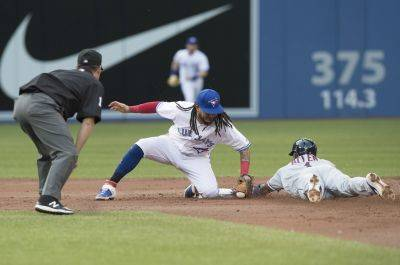 Cleveland's Greg Allen slides safely into second base under the tag attempt by the Blue Jays' Freddy Gaalvis to record a stolen base during the second inning of Tuesday night's game in Toronto. (AP photo)