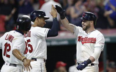 The Indians' Jason Kipnis, right, is congratulated by Oscar Mercado and Francisco Lindor, left, after Kipnis hit a three-run home run during the sixth inning of Wednesday night's game against Houston in Cleveland. (AP photo)