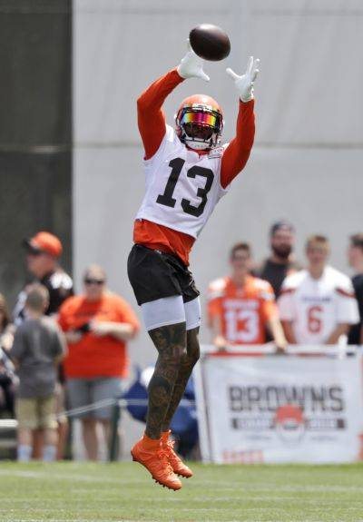 Cleveland wide receiver Odell Beckham Jr. goes airborne to make a catch Thursday during training camp at the team's training camp facility in Berea. (AP photo)