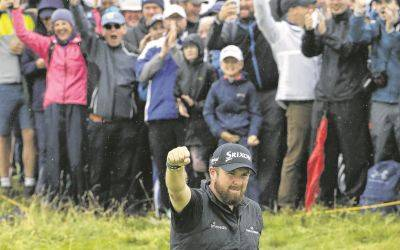 Shane Lowry celebrates after recording a birdie on the 10th hole during Friday's second round of the British Open at Royal Portrush in Northern Ireland.