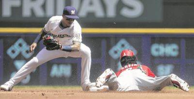 Cincinnati's Phillip Ervin records a stolen base against the Brewers' Orlando Arcia during Wednesday's game in Milwaukee. (AP photo)