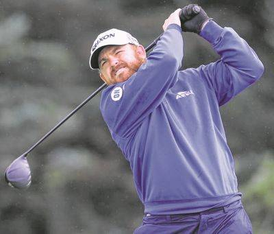 J.B. Holmes watches his tee shot on the fifth hole during Thursday's first round of the British Open  at Royal Portrush in Northern Ireland. (AP photo)