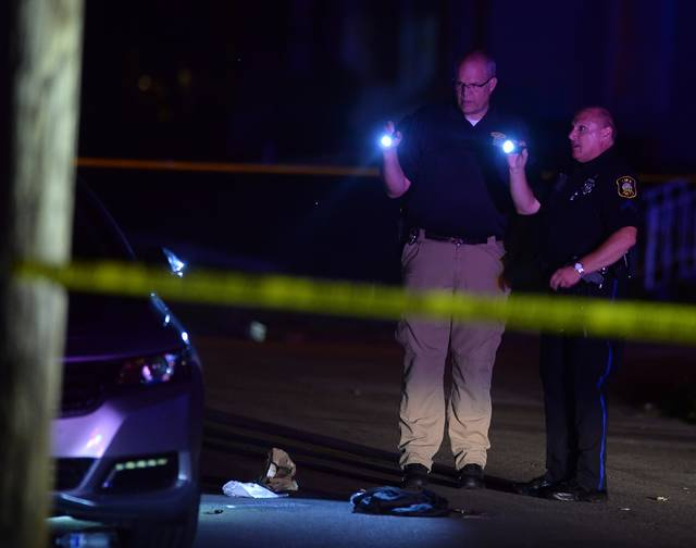The Lima Police Department investigates a homicide by shooting in the 700 block of Franklin Street late Friday night.