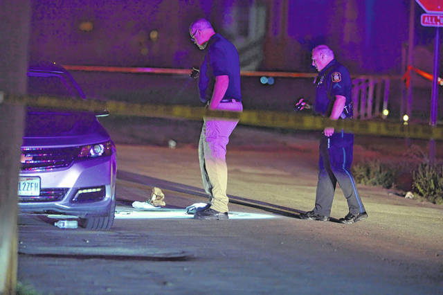 Lima Police Department officers investigate a fatal shooting in the 700 block of Franklin Street late Friday night.