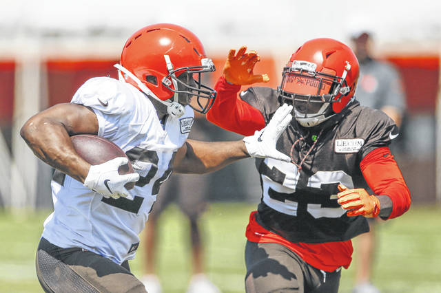 Cleveland's Nick Chubb runs the ball against strong safety Damarious Randall during Monday practice at the team's training facility in Berea.
