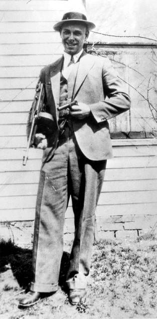 John Dillinger can be seen in 1934 near Moore, Ind. The body of the 1930s gangster is set to be exhumed from an Indianapolis cemetery more than 85 years after he was killed by FBI agents. The Indiana State Department of Health approved a permit July 3 that Dillinger's nephew, Michael C. Thompson, sought to have the body exhumed from Crown Hill Cemetery and reinterred there.