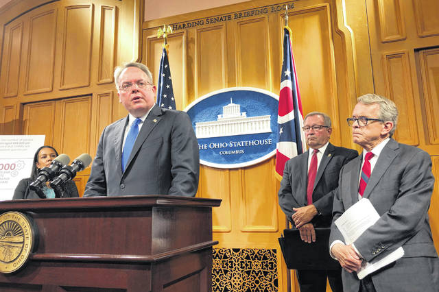 U.S. drug czar Jim Carroll, left, joins Ohio Gov. Mike DeWine, far right, and others at a news conference Friday at the Statehouse in Columbus.