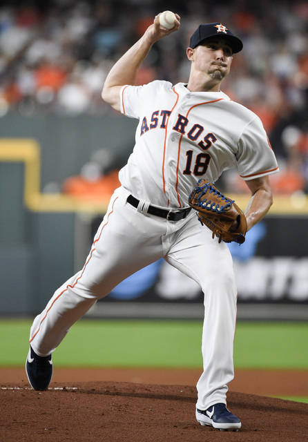 Houston Astros starting pitcher Aaron Sanchez delivers during the first inning of the team's baseball game against the Seattle Mariners, Saturday, Aug. 3, 2019, in Houston. (AP Photo/Eric Christian Smith)