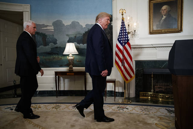 Vice President Mike Pence follows President Donald Trump as he arrives to speak about the mass shootings in El Paso, Texas and Dayton, Ohio, in the Diplomatic Reception Room of the White House, Monday, Aug. 5, 2019, in Washington. (AP Photo/Evan Vucci)