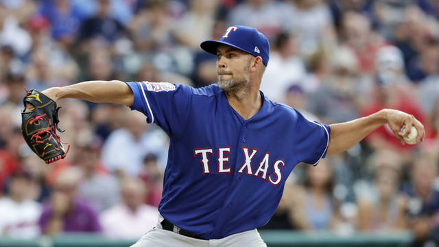 Texas Rangers starting pitcher Mike Minor delivers in the first inning of a baseball game against the Cleveland Indians, Monday, Aug. 5, 2019, in Cleveland. (AP Photo/Tony Dejak)