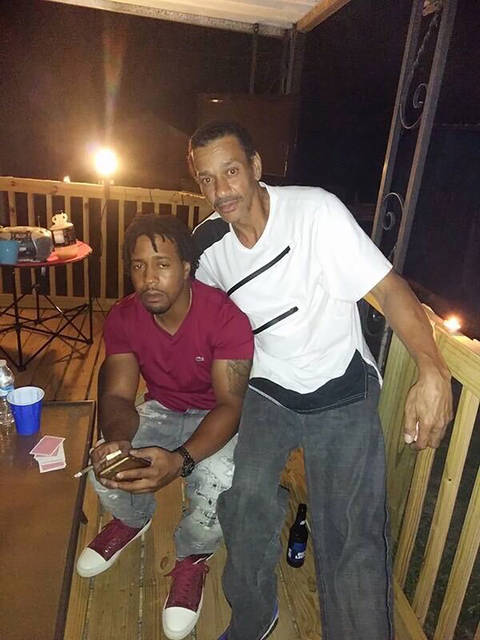 This photo provided by Jeffrey Fudge shows Derrick Fudge with his son Dion Green. Fudge was one of the victims in a shooting at a popular nightlife area in Dayton, Ohio, Sunday, Aug. 4, 2019.  Dion  Green just wanted to have some fun with his family in downtown Dayton after what had been a tough couple of months in the aftermath of damaging tornadoes. But his Saturday night out ended tragically, with his father dying in his arms, his eyes looking into his as he took his final breath.(Jeffrey Fudge via AP)