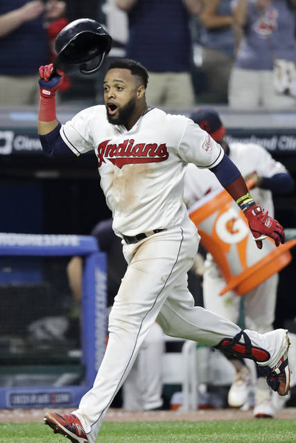 Cleveland Indians' Carlos Santana celebrates after hitting a solo home run in the ninth inning in a baseball game against the Boston Red Sox, Monday, Aug. 12, 2019, in Cleveland. The Indians won 6-5. (AP Photo/Tony Dejak)