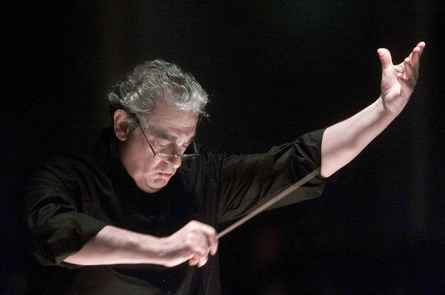 Placido Domingo directs the Washington Opera Orchestra and Chorus during a rehearsal of Verdi's Requiem at Washington's Constitution Hall in 2001. Nine women in the opera world told The Associated Press that they were sexually harassed by Domingo in encounters that took place over three decades, at venues that included the Washington Opera, the Los Angeles Opera and other opera companies.