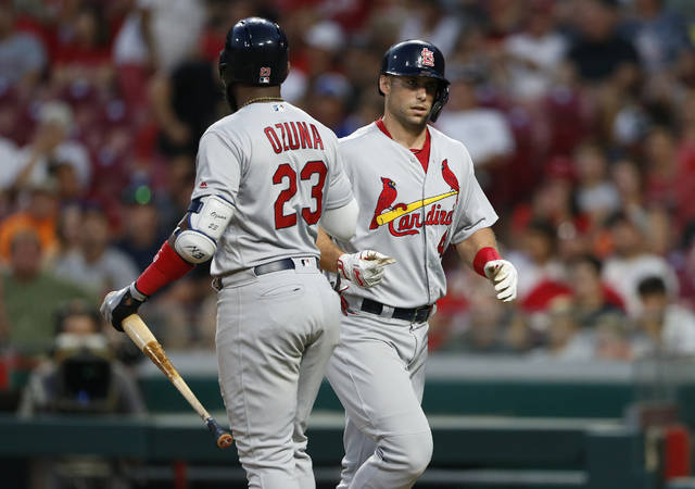 St. Louis Cardinals' Paul Goldschmidt, right, is congratulated on a two-run home run off Cincinnati Reds starting pitcher Luis Castillo by Marcell Ozuna (23) during the fifth inning of a baseball game, Friday, Aug. 16, 2019, in Cincinnati. (AP Photo/Gary Landers)