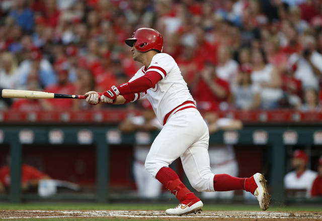 Cincinnati Reds' Jose Iglesias follows through on an RBI single off St. Louis Cardinals starting pitcher Miles Mikolas during the fourth inning of a baseball game Saturday, Aug. 17, 2019, in Cincinnati. (AP Photo/Gary Landers)