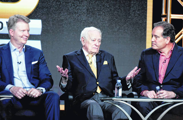 """From left to right, sportscasters Phil Simms, Jack Whitaker and Jim Nantz participate in the """"CBS Sports"""" panel at the CBS 2016 Winter TCA in Pasadena, Calif. Whitaker, whose Hall of Fame broadcasting career ranged from the first Super Bowl to Secretariat's Triple Crown to short essays from major sporting events, died Sunday, CBS reported."""