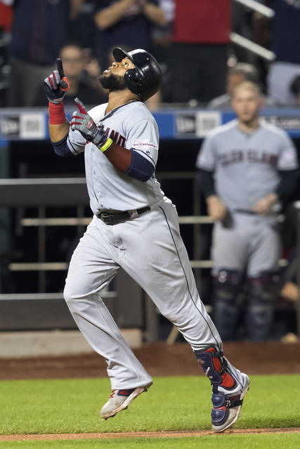 Cleveland Indians' Carlos Santana runs the bases after hitting a home run during the 10th inning of the team's baseball game against the New York Mets, Wednesday, Aug. 21, 2019, in New York. (AP Photo/Mary Altaffer)