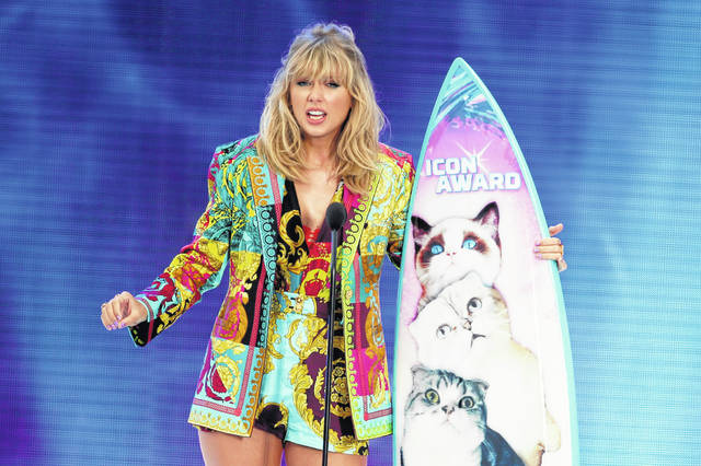Taylor Swift accepts the Icon award at the Teen Choice Awards in Hermosa Beach, Calif., on Aug. 11. Swift plans to re-record her songs after her catalog was purchased by popular music manager Scooter Braun.