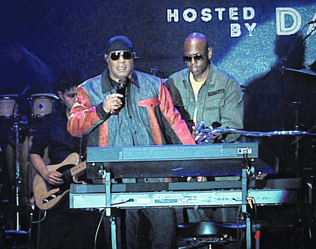 "Musician Stevie Wonder, front left, and comedian Dave Chappelle appear on stage during the ""Gem City Shine"" event in the Oregon District in Dayton on Sunday. Chappelle, who resides in nearby Yellow Springs, hosted the special block party and benefit concert for those affected by the recent mass shooting."