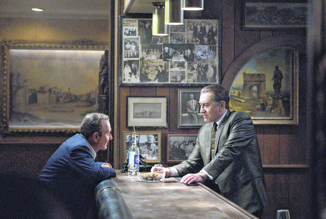 "This image released by Netflix shows Joe Pesci, left, and Robert De Niro in a scene from ""The Irishman."" Netflix said Tuesday that ""The Irishman"" will open theatrically Nov. 1 and begin streaming on Nov. 27."