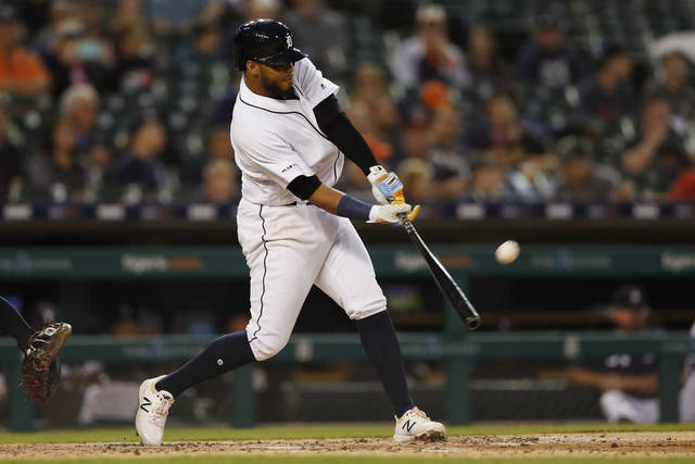 Detroit Tigers' Dawel Lugo connects for a solo home run during the fifth inning of a baseball game against the Cleveland Indians, Wednesday, Aug. 28, 2019, in Detroit. (AP Photo/Carlos Osorio)