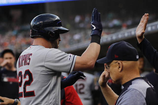 Cleveland Indians' Jason Kipnis is greeted in the dugout after a solo home run during the second inning of a baseball game against the Detroit Tigers, Wednesday.