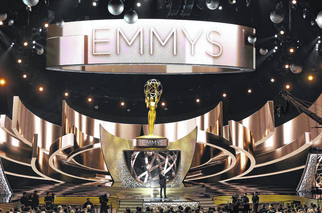 "FILE - This Sept. 18, 2016 file photo shows the main stage during the 68th Primetime Emmy Awards in Los Angeles. There will be no host at the ceremony honoring TV's best next month. Fox Entertainment CEO Charlie Collier said Wednesday, Aug. 7, 2019, that going host-less allows more time to salute departing shows, including ""Game of Thrones."""