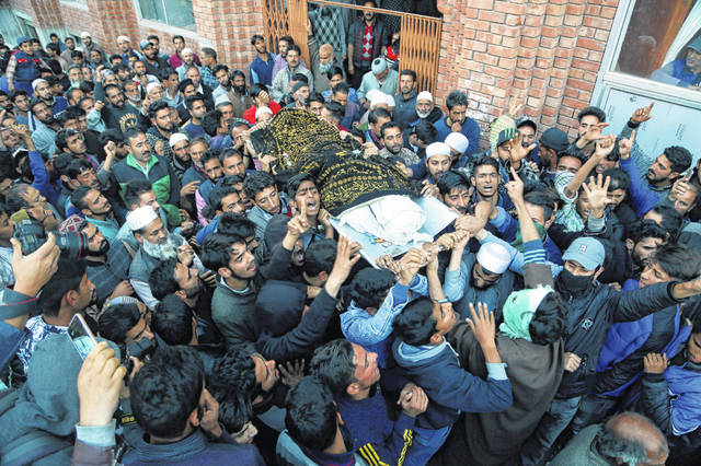 FILE - In this Sunday, Oct. 21, 2018 file photo, Kashmiri villagers carry the body of Uzair Mushtaq during his funeral in Kulgam, 75 kilometers (46 miles), south of Srinagar, Indian controlled Kashmir, after three local rebels were killed in a gunbattle with Indian government forces in disputed Kashmir on Sunday, and six civilians were killed in an explosion at the site after the fighting was over, officials and residents said. On Friday, Aug. 16, 2019, The Associated Press reported on a video circulating online incorrectly identified as the aftermath of a recent Indian attack on Kashmiris seeking independence from India. The old footage shows shows the aftermath of an explosion from earlier on Oct. 21, 2018.