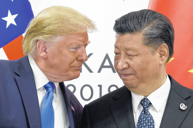 FILE - In this June 29, 2019, file photo, President Donald Trump, left, meets with Chinese President Xi Jinping during a meeting on the sidelines of the G-20 summit in Osaka, Japan. China has announced it will raise tariffs on $75 billion of U.S. products in retaliation for President Donald Trump's planned Sept. 1 duty increase in a war over trade and technology policy.