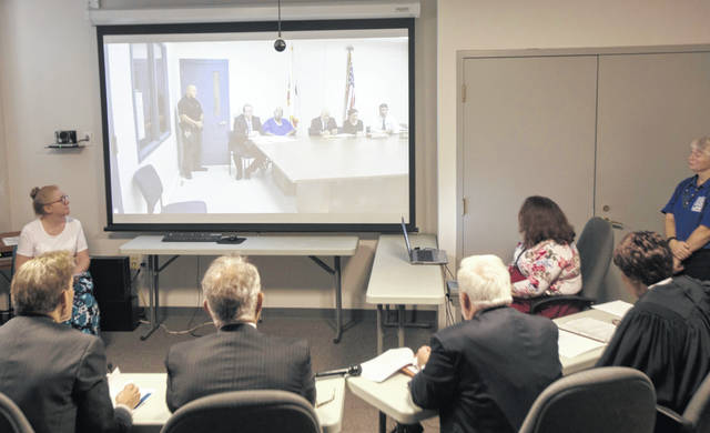 Samuel Little pleas guilty to killing two women in Cincinnati in the 1980s while appearing via Skype from the California state prison to the Hamilton County Courthouse in Cincinnati on Friday, Aug. 23, 2019. Authorities have said they have confirmed at least 60 of the 93 slayings he says he committed in 14 states while he crisscrossed the country for decades.