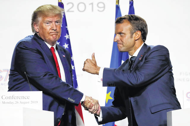 French President Emmanuel Macron and U.S President Donald Trump shake hands during the final press conference during the G7 summit Monday, Aug. 26, 2019 in Biarritz, southwestern France. French president says he hopes for meeting between US President Trump and Iranian President Rouhani in coming weeks.