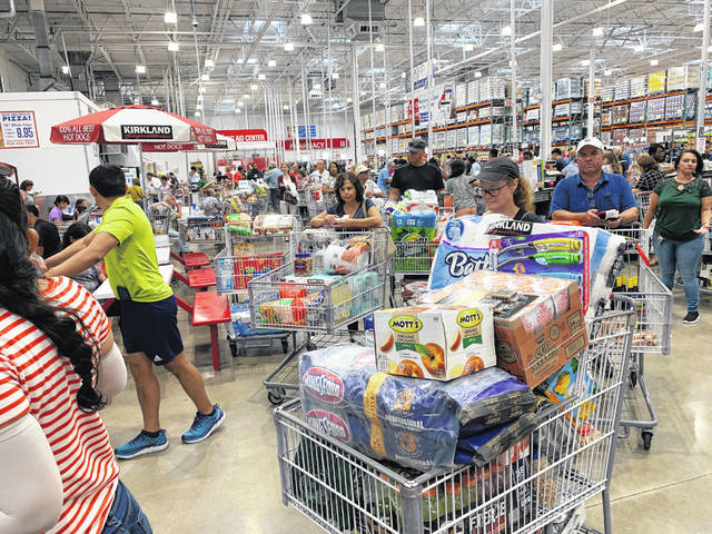 Shoppers wait in long lines at Costco, Thursday, Aug. 29, 2019, in Davie, Fla., as they stock up on supplies ahead of Hurricane Dorian.