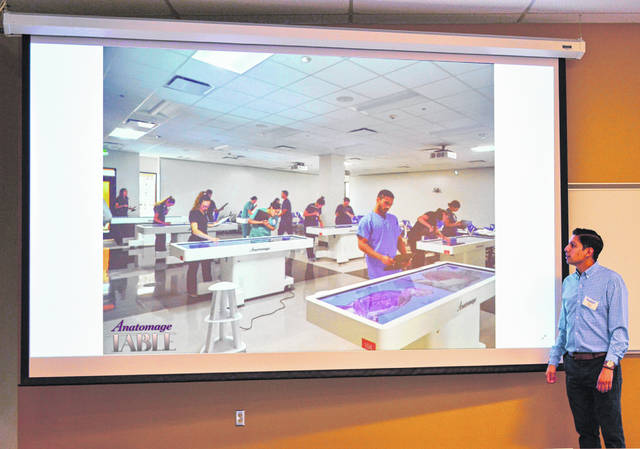 An Anatomage representative runs through the capabilities of its medical imaging table, which can provide a 1-to-1 computer model of a cadaver for students to manipulate on a giant table-sized touch screen.