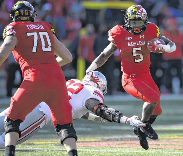 Maryland running back Anthony McFarland (5) runs the ball against Ohio State defensive tackle Haskell Garrett (92) during the Buckeyes' 52-51 win over the Terrapins last season.