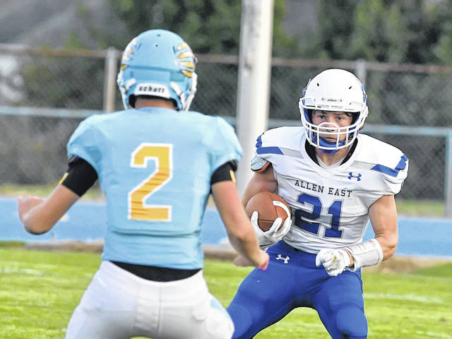 Allen East's Carter Young looks to get past Bath's Dallin McDermott during Friday night's game at Bath.